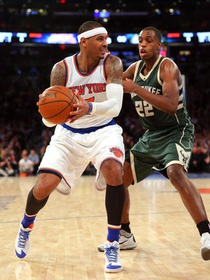 Jan 10, 2016; New York, NY, USA; New York Knicks small forward Carmelo Anthony (7) controls the ball against Milwaukee Bucks shooting guard Khris Middleton (22) during the third quarter at Madison Square Garden. The Knicks defeated the Bucks 100-88. Mandatory Credit: Brad Penner-USA TODAY Sports