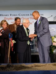 Wright Lassiter III, President and CEO of Henry Ford Health System (right) thanks Mort Harris for his donation and gratitude after the groundbreaking for the Brigitte Harris Cancer Pavilion in Detroit on Tuesday, June 6, 2017.