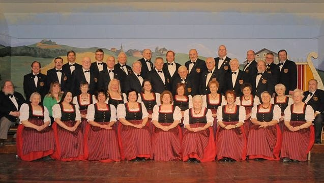 Singers from Germania pose for a photo.