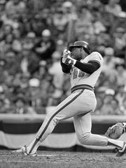 In this Oct. 9, 1982, file photo, California Angels' Don Baylor hits a grand slam against the Milwaukee Brewers in the eighth inning in Milwaukee.