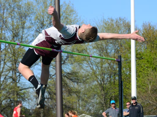 Genoa's Kyle Bihn competes in the high jump at Oak Harbor on Friday evening.