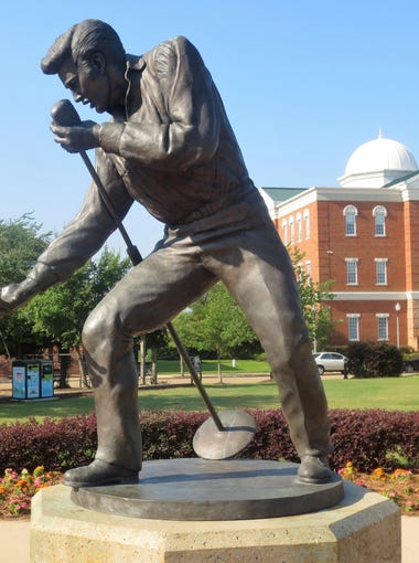 """The """"Homecoming Statue"""" of Elvis Presley in front of Tupelo City Hall in Mississippi."""