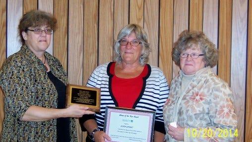 "Glenda Gephart, center, was named Southern Finger Lakes Women's ""Woman of the Year."" Presenting the award are Brenda Gill, left, group treasurer, and Mary Ellen Morgan, group president."
