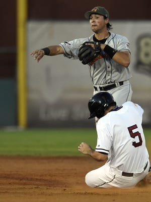 Alfredo Rodriguez of the Joliet Slammers forces out Jeff Gardner while attempting to turn a double play during the Frontier League Divisional series last year. Rodriguez has signed to play with the Somerset Patriots this year.