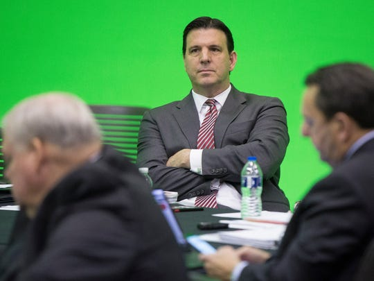 Ball State Board of Trustees Chairman Rick Hall talks with other board members during a committee meeting on Friday in the Ball Communications Green Screen Studio.