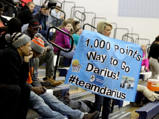 A fan holds up a sign after R.E. Lee's Darius George