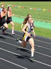 Winnett-Grass Range runner Zoe Delaney leads at an