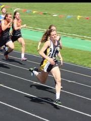 Winnett-Grass Range runner Zoe Delaney leads at an