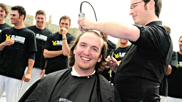 Scott Klever parted with his locks for a Xavier baseball fundraiser Sunday afternoon.