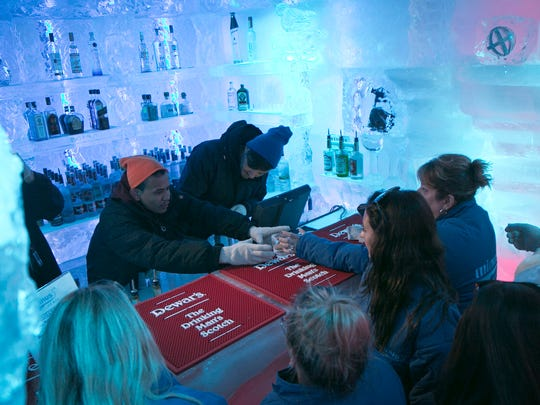 Bartenders serve customers at the Minus 5 ice bar.