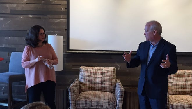 Heather George, left, senior vice president for brand strategy for Lowes Foods, talks to Joe Erwin at a Collaborators and Cocktails presentation at Endeavor in downtown Greenville Wednesday, April 26, 2017.