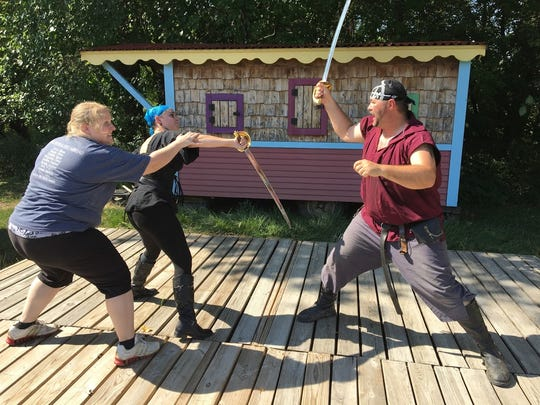 Amanda Jackson, Kathry Kozuki and Buddy Jackson duel for leadership of their pirate ship in an act of the Bawdy Buccaneer's production for the 12th Des Moines Renaissance Faire set for the first three weekends in September.