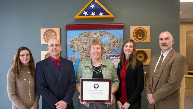 Moraine Park Technical College was named to Victory Media's 2016 list of Military Friendly Schools – the sixth consecutive time Moraine Park has earned this honor. Shown here receiving Moraine Park's latest Military Friendly award is (from left) Stephanie Lueck, financial aid specialist; Scott Lieburn, dean of students; Bonnie Baerwald, president; Kimberly DeMaa, financial aid specialist; and Stephen Pepper, student veterans specialist.