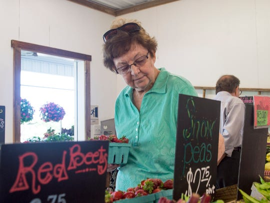 Beryl Myers looks to buys some fresh strawberries and vegetables at Hess Orchards on Thursday, June 9, 2016.