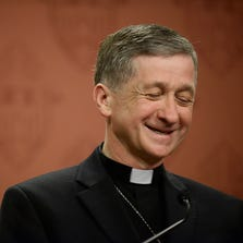 Newly appointed Archbishop of Chicago, Archbishop Blase Cupich speaks to the media after it was announced that he would replace Cardinal Francis George, retiring leader of the Chicago Catholic Archdiocese during a news conference in Chicago on Saturday
