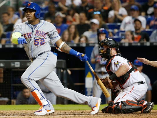 New York Mets' Yoenis Cespedes (52) hits a two-run double during the ninth inning of a baseball game against the Miami Marlins, Tuesday, April 10, 2018, in Miami. The Mets defeated the Marlins 8-6. (AP Photo/Wilfredo Lee)