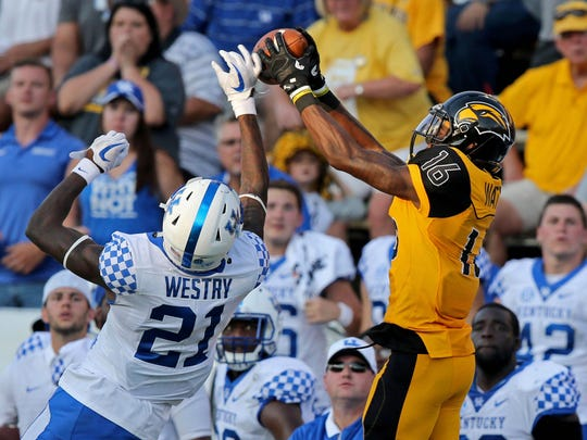 Southern Miss wide receiver Quez Watkins (16) makes a catch while defended by Kentucky cornerback Chris Westry (21) Saturday.