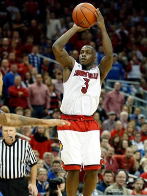Louisville's Chris Jones pulls up for the jumper.   Dec. 27, 2014