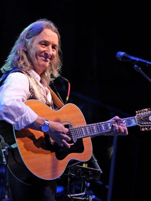 """Supertramp lead-singer Roger Hodgson entertains a large Friday night crowd at the Blue Ash Town Square main stage. His composition """"Give a Little Bit"""" was a mega-hit in 1977."""