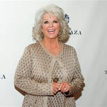 In this file photo, TV personality Paula Deen attends the EVINE Live launch event in New York. Hachette Book Group announced Monday that it had reached a distribution deal with the celebrity chef's Paula Deen Ventures.