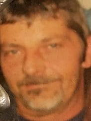 Tom Moon, 52, died early Tuesday after he was shot