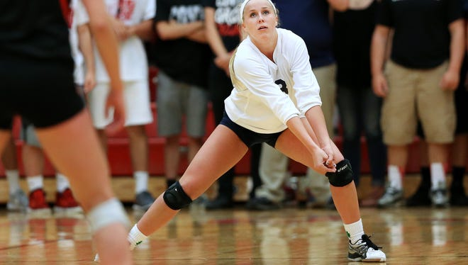 Cathedral's Kendall White fields a serve against Center Grove during their match held at Center Grove High School on Tuesday, August 25, 2015. Cathedral pulled off the win in the 5th set.