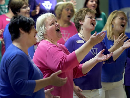 Fox Valley Chorus members Carol Christiansen, left,