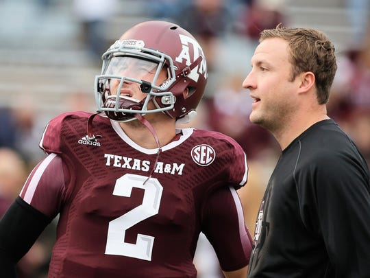 Johnny Manziel (2) dazzled college football fans in two seasons at Texas A&M, winning the Heisman Trophy in 2012.