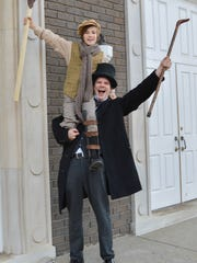 """George Downer plays the role of Ebenezer Scrooge and Andrew Hansen is Tiny Timin Center for the Arts production of """"A Christmas Carol."""""""