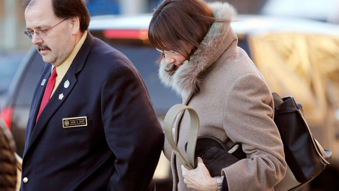 New Hampshire state Rep. Susan DeLemus, right, leaves the Federal Courthouse with state Rep. John Burt after attending a hearing for her husband Gerald DeLemus Thursday March, 3, 2016 in Concord, N.H. DeLemus of Rochester, N.H. was arrested on allegations that he organized and led armed patrols and security checkpoints for several weeks after a tense armed confrontation in April 2014 near Cliven Bundy's melon farm and cattle ranch in Bunkerville, Nevada.