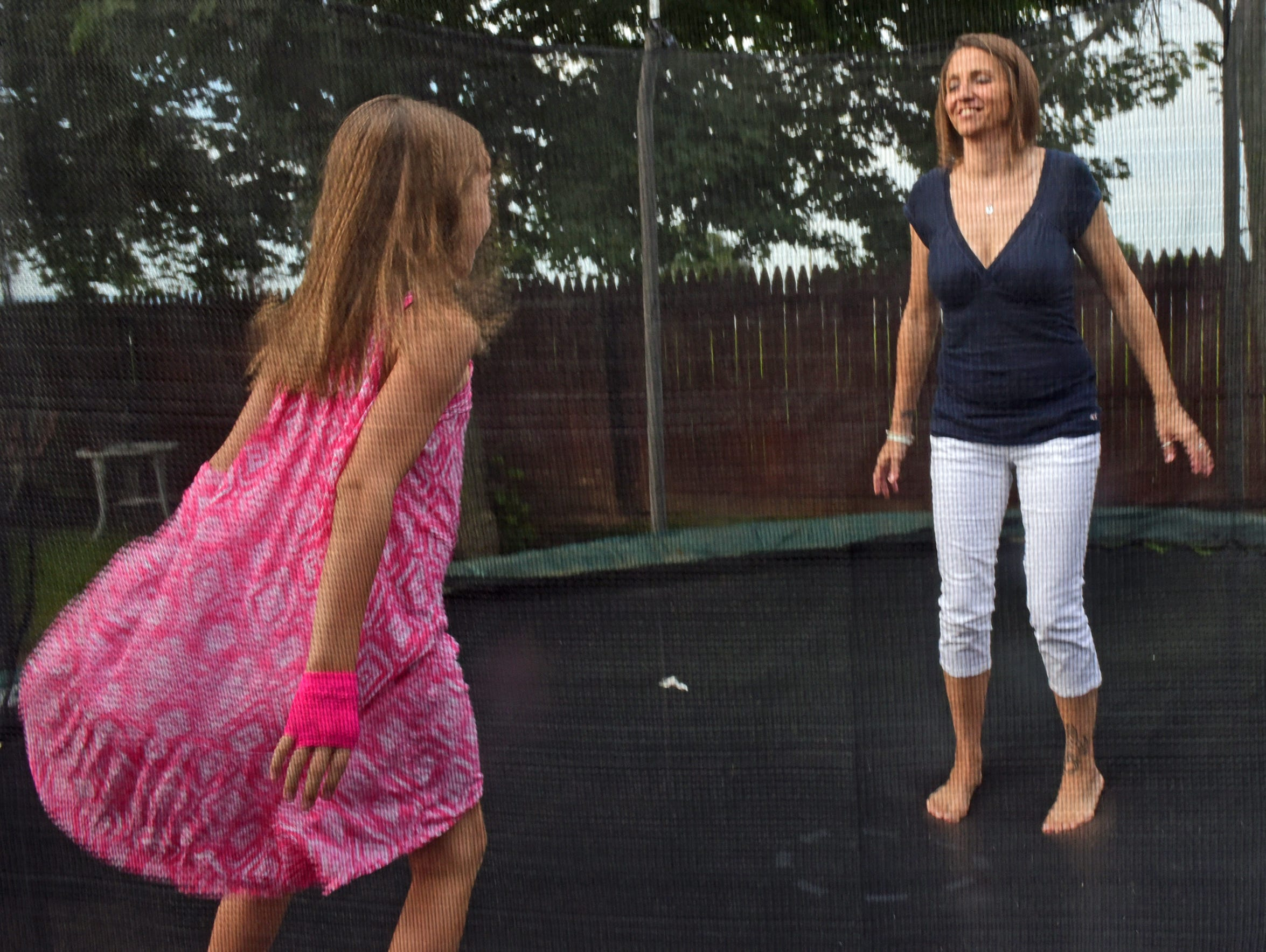Staci Harrison plays with her daughter,  Lela, 7, in