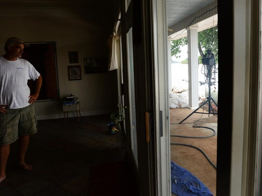 Bill Carrier used sandbags to keep his house dry from floodwaters. A new flooding threat looms.