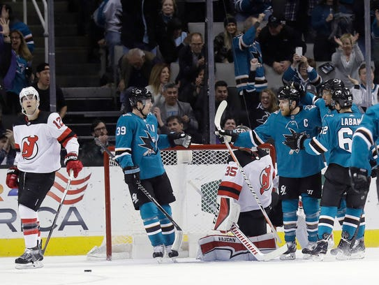 San Jose Sharks' Joe Pavelski, third from right, is