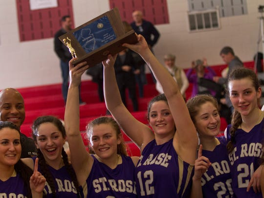 St Rose's Kat Phipps and Jess Louro hoist their championship