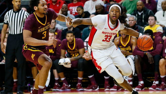 Rutgers Scarlet Knights forward Deshawn Freeman (33) dribbles the ball around Minnesota Golden Gophers forward Jordan Murphy (3)