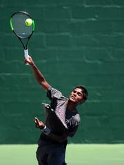 Pranac Kumar, from Plano,  slams a ball at the net