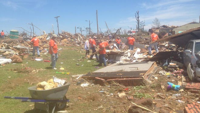 Samaritans Purse helping with clean up after a house was leveled in Louisville, Miss.