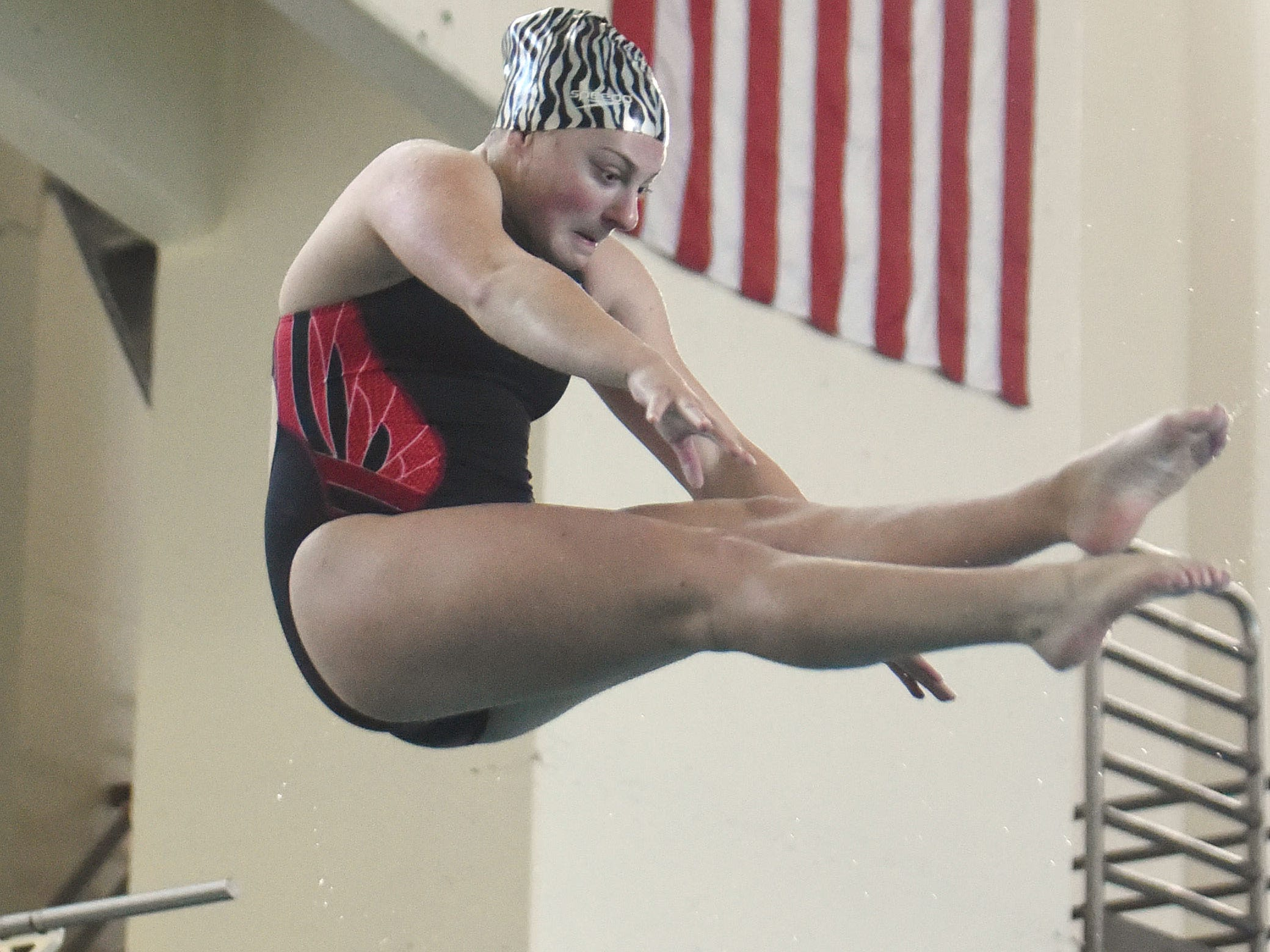 Silverton's Madison Cock, who has signed a letter of intent to compete in diving at the University of Utah, dives during practice on Wednesday, April 15, 2015, at the Tualatin Hills Park & Recreation Center in Beaverton.