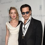 Johnny Depp and Amber Heard on Jan. 10, 2015 in Los Angeles.