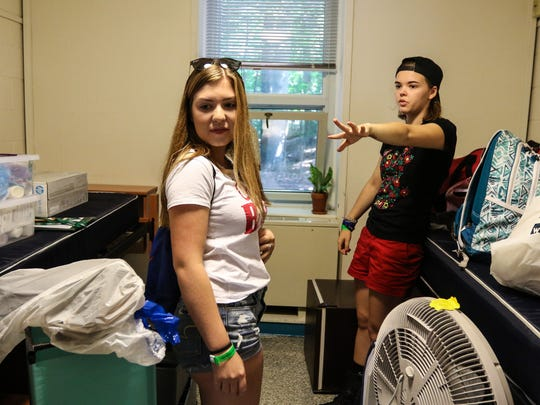 Alison Kipe, of High Bridge talks to her new roommate Jamie Roth, on left, of Monroe during Move-in day at Drew University on August 24, 2017.  Alexandra Pais/ The Daily Record