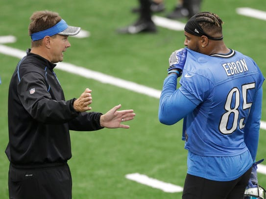 Tight end Eric Ebron speaks with a coach during practice