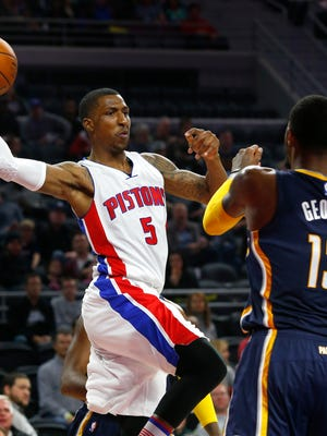 Pistons guard Kentavious Caldwell-Pope (5) passes against Pacers forward Paul George (13) in the second half of the Pistons' 118-96 win Saturday at the Palace.