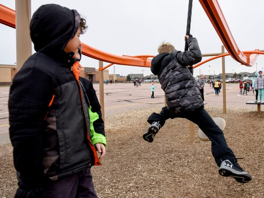 Students at R.F. Pettigrew Elementary School play on playground equipment purchased by the school's PTO over the past few years.
