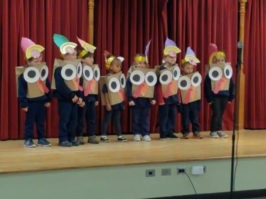 Pre-schoolers, who dressed as paper turkeys, brought