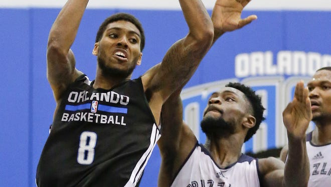 Devyn Marble, a former Hawkeye and now an NBA rookie with the Orlando Magic, plays during a summer league basketball game in Orlando, Fla.