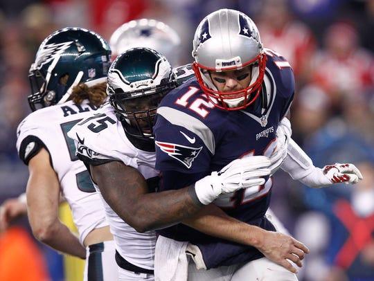 New England Patriots quarterback Tom Brady (12) is