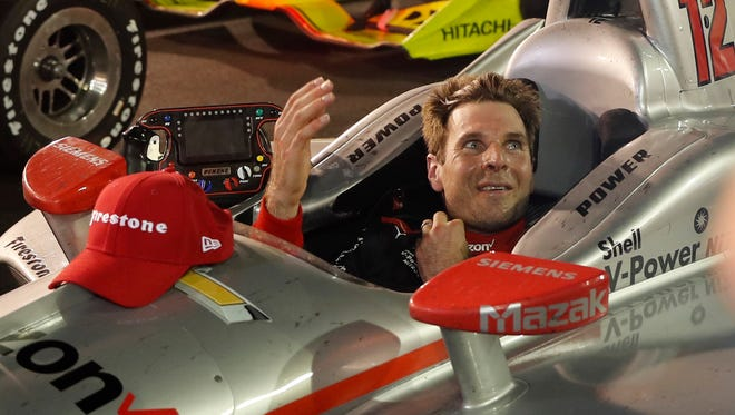 Will Power, of Australia, celebrates as he sits in his car after winning the IndyCar auto race at Gateway Motorsports Park on Saturday, Aug. 25, 2018, in Madison, Ill.