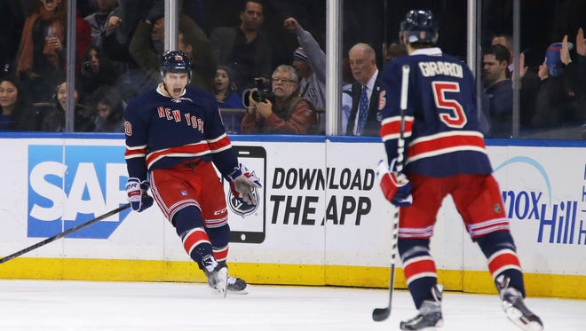 Chris Kreider (left) came out of the Rangers' lineup with neck spasms Sunday, just as Dan Girardi (right) returned from a groin injury.