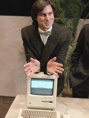 In this Jan. 24, 1984 file photo, Steve Jobs leans