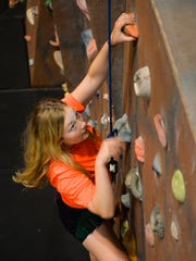 CareerONE summer camp participant Erika Langner, 15, takes a turn climbing the Mountain Dew Extreme climbing wall at St. Cloud State University Thursday, July 21, in St. Cloud. The CareerONE program introduces kids to careers and teaches them the basics about applying for jobs and adopting a good work ethic.